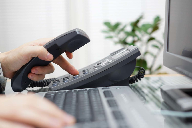 A landline phone and a computer keyboard.